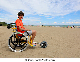 boy on the special wheelchair with aluminum alloy wheels to...