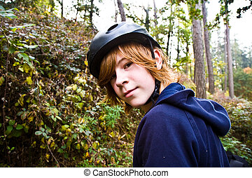 young boy on tour with the bike, being happy and self confident