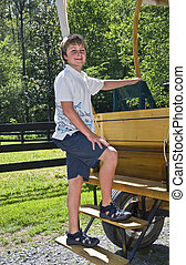 Young Boy on Wagon