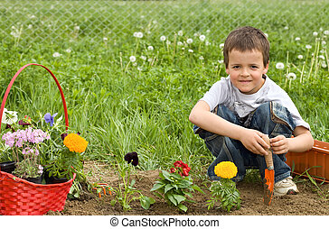 Young boy planting flowers
