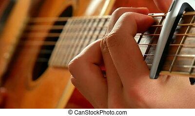 Young boy play guitar, close up