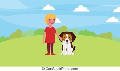 young boy play with his dog in the park