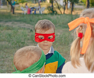 Young boy playing at a kids birthday party