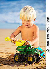 Young boy playing at the beach