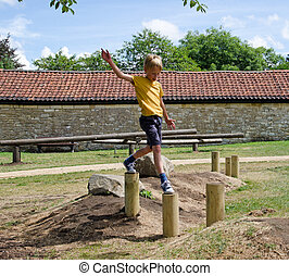 Young boy playing in a playground