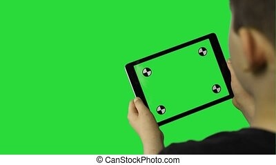Young boy playing on his tablet computer Hd