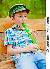 Young boy playing recorder