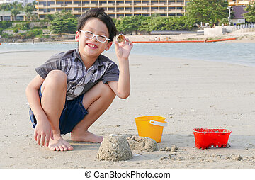 Young boy playing sand