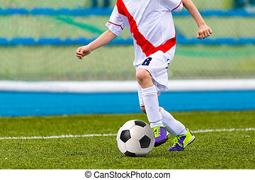 Young Boy Playing Soccer Football Match