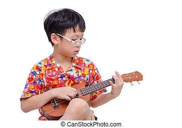 Young boy playing ukulele over white