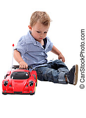 Young boy playing with a toy car