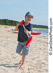 Young boy playing with sand