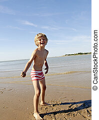 Young Boy playing with the Sand