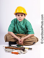 Young boy playing with tools for work