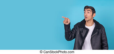 young boy pointing isolated on background with space
