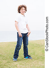Young boy posing with hand in pocket
