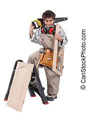 Young boy pretending to be a carpenter