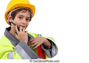 Young boy pretending to be a traffic guard