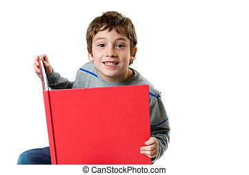 young boy reading a big red book