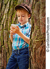 Young boy reading sms