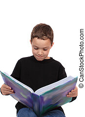 Young boy reading textbook
