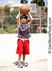 Young boy ready to shot basketball