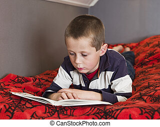 Young boy reding a book