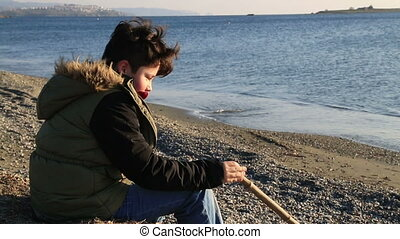 Young boy relaxing at the seaside