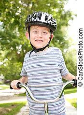 Young boy riding a bike