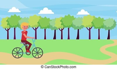 young boy riding bike in the park road