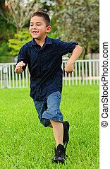 young boy running