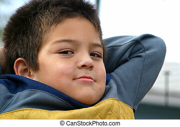Young Boy Satisfied - Close up portrait of a young boy with...