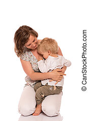 Young boy sitting on mother lap
