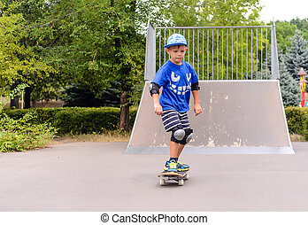Young boy skateboarding at the park