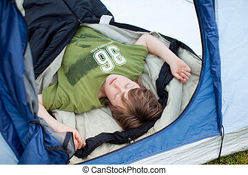 Young Boy Sleeping In Tent