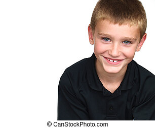 boy smiling - young boy smiling - wearing a black shirt
