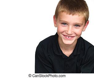 boy smiling - young boy smiling - wearing a black shirt