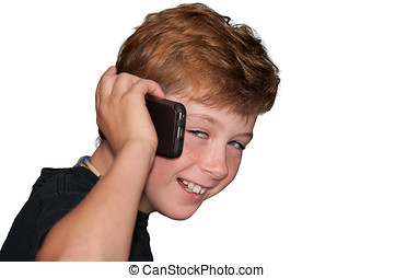 Young boy smiling while talking on a cell phone