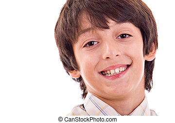 Young boy smiling, with pensive expression, close up. Isolated over white background.