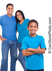 young boy standing in front of parents