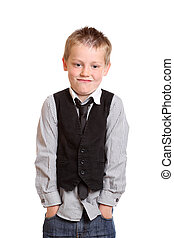 Young Boy smirking at camera with hands in pockets