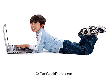 Young boy surfing on his laptop