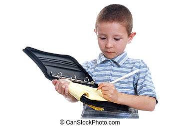 Young Boy Taking Notes - Young boy writing in a notebook