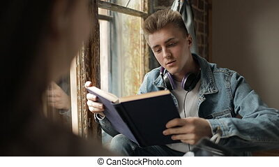 Young boy Talking to an other Student - Young boy reading...