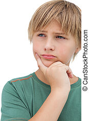 Young boy thinking about something