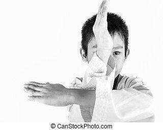 Young boy training taekwondo action isolated