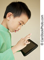 Young boy use to tablet pc