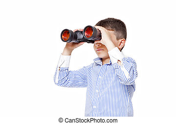 Young boy using binoculars