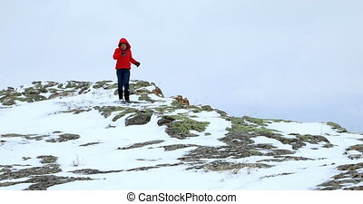 Young boy walking on the snowy hill - Young boy trip on ice...