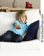 Young Boy Watching Television at Home